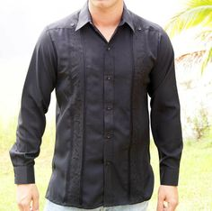 Embroidered Casual Shirt for  Men with a Linen Look,  Long Sleeve non pockets. Black - Traditional Cuban Style.  Best Seller Guayabera. poly cotton fabric with a linen Look.Lightweight and Wrinkle free.These guayaberas are done in fine micro fiber that is cool.. Machine washable, cold wash. Wash and wear.Available is subject to change.