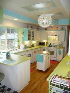 Amazing lime retro kitchen- and her before pictures of the red retro kitchen are just as cute! http://www.bellacor.com/productdetail/elk-lighting-18124-4-circeo-antique-white-four-light-pendant-1481034.htm?partid=social_pinterest