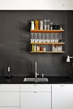 Black and white kitchen with string shelf
