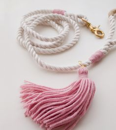 Pink Dog Leash / Wedding Dog Leash Nautical dog leash made from 3 strand cotton rope, accented with rose and gold. Its the classic rope dog lead, dressed up with a little bit of color, style and saltiness. Use it for weddings, parties or make every day special. The dusty pink color scheme is brand new and Ill confess I am in love with it! Blush has been my go-to favorite shade for years but this slightly deeper rose hue feel so fresh and current. The pink is slightly muted so instead of…