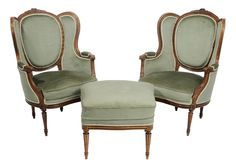 Pair Louis XVI Style CarvedBeechwood Upholstered [Bergeres,] Ottoman  French, early 20th century, chairs with ribbon-carved crests and leaf-carved arms and arm supports, pale green/blue upholstery, 40-1/2 x 29 x 23 in.; together with a matching ottoman upholstered [en suite,] 19 x 25 x 25 in.generally good condition, some cracks and minor repairs at joints, scattered minor upholstery flaws (some tape loose)			  	  			Private Collection  			Estimate: $500 - $800