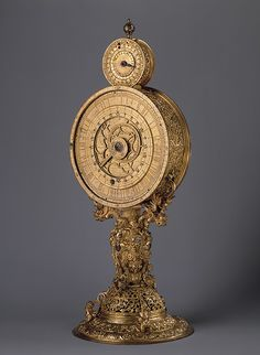 Monstrance Clock or Mirror Clock, ca. 1570  Made in Nuremberg, Germany  Case of gilt bronze; dial of gilt brass; movement of steel