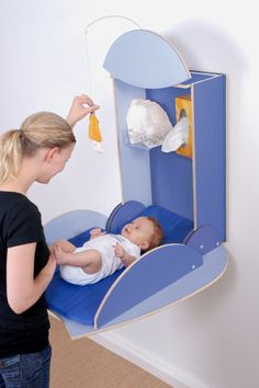This is such a better idea than a regular changing table. Stow and go!