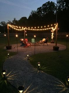 DIY Outdoor fire pit with sweet ambiance effect! This guy uses limestone for the walkway and seating area. I think for my house I would use pavers. Pavers would be more work though. outdoor fire pit DIY Fire Pit and Seating Area Cheap Fire Pit, Diy Fire Pit, Fire Pit Backyard, Backyard Seating, Cozy Backyard, Garden Seating, Outdoor Seating, Deck With Fire Pit, Outdoor Fire Pits