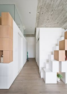 Doehler loft renovation by SABO Project features an irregular clustered storage unit