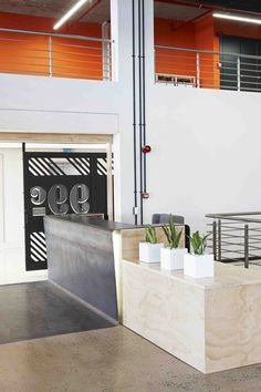 99c offices by Inhouse Brand Architects features<br /> a waiting room inside a shipping container
