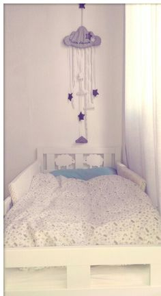 Baby boy light blue grey and white nursery. Bed with sweet sheeps IKEA, pillow PRIMARK, wall decor MAISONS DU MONDE