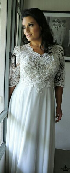 Modest plus size lace and chuffon wedding dress with sleeves that gives you a fashion forward look without revealing too much skin. PAOLA. STUDIO LEVANA. 2018