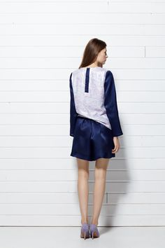 #PLAKINGER #SS15 #collection #LOOK XI Slightly #oversized #top is #made from a #pastel #multicolored, #painted #print #sequins and navy #blue #silk #organza. Panels of the navy blue silk organza frame the invisible zipper on the back. Flared #shorts cut from a #delicate, navy blue silk organza. #byplakinger.com #fashion #feminine #style #newcollection #ss2015 #springsummer15 #emergingdesigner #collection #brand #fashiondiary #fashiondesign #fashionstyle #collection #luxurious #luxury