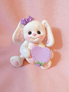 zoom Item Details        (1,031)   Shipping & Policies BUNNY RABBIT ORNAMENT / CAKE TOPPER: I handcrafted this little rabbit without the u...