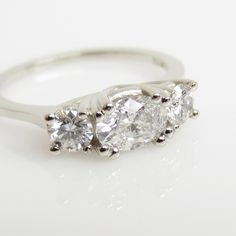 LOVE! Brilliant Diamond horizontal oval round prong set Three stone Engagement ring 18k white gold - Custom made ring to order. $5,345.00, via Etsy.