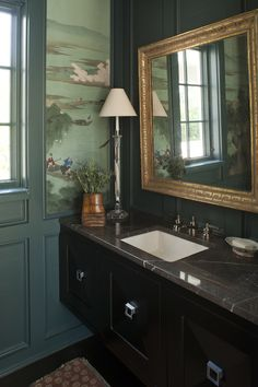 Traditional bathroom with teal painted trim and wood work, chinoiserie wallpaper, and floating marble vanity