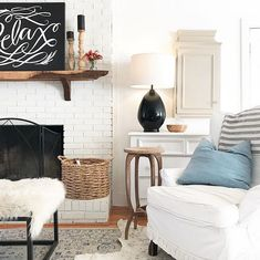 "The ""relax"" chalk sign. Basket by white brick mantel (I already have it that way). Light, positioning of chair."