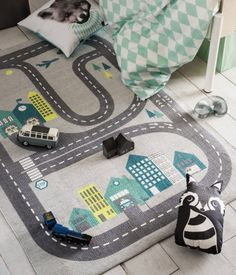 Light gray/car track. Rectangular cotton rug with a printed pattern at front and non-slip backing.