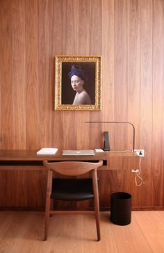 Danish chair with simple wooden desk and wall.