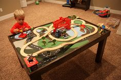 DIY Train table! Found an old beaten up one and restored it for jimmy for christmas! One side is for trains, flip it over and use it for cars! He loves it:-)