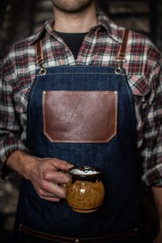 Nothing wrong with a coffee-loving man in an apron. Denim and leather apron is handcrafted by Authentic Sundry. Made in the USA.
