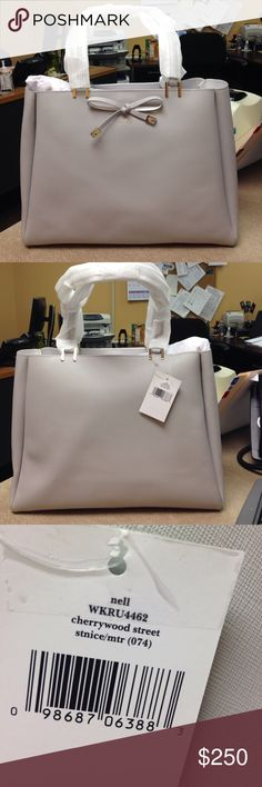 Kate Spade Cherrywood Street. Gray in color. Brand New Never Used Kate Spade Cherrywood Street Leather Should Bag. Gray in color. This beautiful bag measures 11 inches height by 13 inches across handle drop is 7 1/2 inches. This is a large bag that can carry all your needs. kate spade Bags Shoulder Bags
