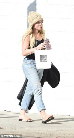 Moving forward: Duff heads to her vehicle after picking up some goodies at the popular LA ...