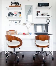 Side by Side  One wall can be easily divided into two productive spaces. A smart design choice would be one long desktop (it should be large enough for two people to comfortably work side by side) and sleek roll up chairs.