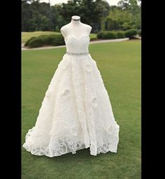 100 Sentimental Wedding Ideas:Displaying ancestry wedding gowns either along the path to your Ceremony or in a vignette at your ceremony -  Gather the gowns of your future mother-in-law and your grandmothers as well, if they saved them - lovely idea, plus it gives guests something to 'do' while waiting for your arrival at Reception.