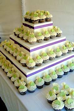 purple and yellow cakes | cakes or miniature desserts. Each tier is decorated with purple ...