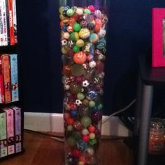 A collection of bouncy balls in a vase
