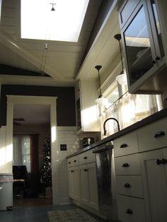 shiplap wood ceiling, cable lights, schoolhouse pendant lights