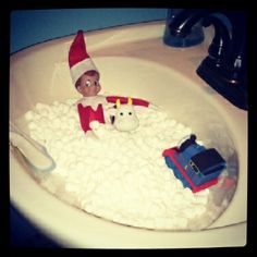 Tuna's (Elf on the Shelf) first night! Marshmallow bath with the kids' bath toys!