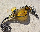 Golden yellow seahorse by palmeras