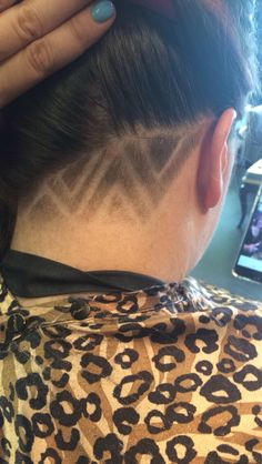 Shaved underneath with graphics done at Trimz Hair Salon in Morris , IL
