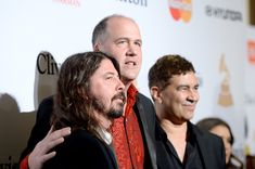 Dave Grohl Krist Novoselic Photos - (L-R) Recording artists Dave Grohl, Krist Novoselic, and Pat Smear attend the 2016 Pre-GRAMMY Gala and Salute to Industry Icons honoring Irving Azoff at The Beverly Hilton Hotel on February 14, 2016 in Beverly Hills, California. - 2016 Pre-GRAMMY Gala And Salute to Industry Icons Honoring Irving Azoff - Arrivals