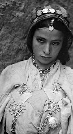 """Beautiful Moroccan Jewish woman named """"Besancenot"""", from the South High Atlas Mountains, taken between 1932-39."""