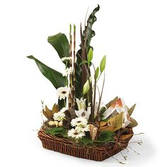 twisted willow and chocolate coloured flax set off with bold greenery and rich creamy gerberas and lilies