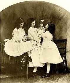 real Alice liddell playing with sisters, by Lewis Caroll