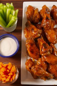 There's nothing like homemade buffalo wings on game day. Frying wings can be messy and involved, and it's not what you want to be doing when the game is on. Baking the chicken is way easier and yields just as crispy results. Buffalo Chicken Recipes, Spicy Chicken Recipes, Thai Recipes, Turkey Recipes, Dinner Recipes, Dessert Recipes, Baked Chicken Wings, Chicken Bombs, Thai Chicken