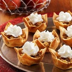 Easy mini apple pie tart recipe with fresh apple, cinnamon and almond crumble tucked inside pastry cups.