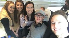 Niall and Olly Murs with fans on the train from Manchester to London