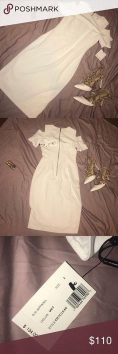 Brand NWT Calvin Klein Dress White cold shoulder dress, tags still attached, never worn. I bought this dress for my law school graduation but never ended up wearing it. Perfect for graduation or bridal shower!! I can post a pic of me wearing it so you can see the length/how it fits. Feel free to make an offer😊 Calvin Klein Dresses Midi