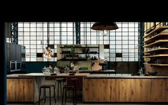 The Factory a  reclaimed kitchen kitchen cabinets by Aster Cucine.