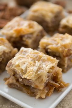 This pecan pie baklava recipe consists of layers of pecans and butter between phyllo dough, baked and then smothered in sweet syrup to get that pecan pie flavor.