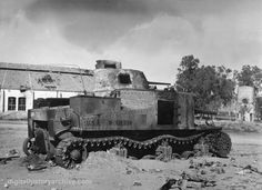 WWII, 1943 - An American M3 Tank destroyed by a German 88mm round.  Saned, Tunisia, February 3, 1943.