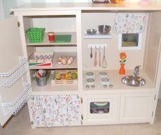 Repurposing an entertainment center as a play kitchen...genius!