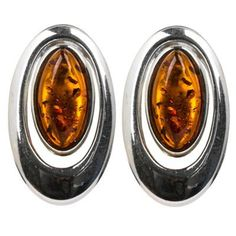 Sterling Silver Amber Earrings. Amber is organic material with healing properties. Weight of amber is traditionally calculated in grams, not carats like precious gemstones. Market value of amber is approximately the same as silver and price for finished piece of jewelry calculated by total weight of the product.