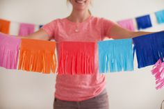 I'm excited to share a colorful, easy, and super budget-friendly party DIY with you today! I used these Tissue Fringe Garlands in a recent Fiesta-themed pr