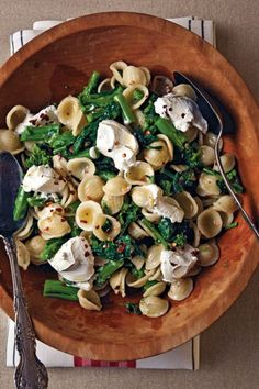 Slightly bitter rapini (also known as broccoli rabe) marries well with tangy goat cheese in a pasta recipe that's ideal for summer picnics and potlucks.