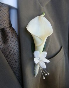 Looks nice.  Especially if the girls have plumeria and calla lily bouquets Wedding Boutonniere, Boutonnieres, Calla Lily Boutonniere, Calla Lily Bouquet, Calla Lillies, Diy Bouquet, Calla Lily Wedding, Lily Wedding Bouquets, Blue Wedding