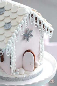pale pink frosted gingerbread house