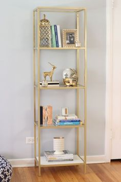 Spray paint an IKEA VITTSJO bookcase/shelving unit gold