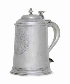 THE JOSEPH SEWALL SILVER TANKARD -  MARK OF JOHN EDWARDS, BOSTON, CIRCA 1730 -  Tapering cylindrical, the stepped domed cover with baluster finial, the scroll handle with oval terminal, the front engraved with the arms of Sewall and engraved under base: Given to the South-Church./1730, marked near handle and on cover with Kane mark C, also with paper label 1480.11 Old South  8 ¾ in. (21.9 cm.) high; 29 oz. (910 gr.)